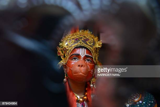 TOPSHOT An Indian child dressed as Hindu god Lord Hanuman waits to perform during a fancy dress competition at a school in Amritsar on November 26...