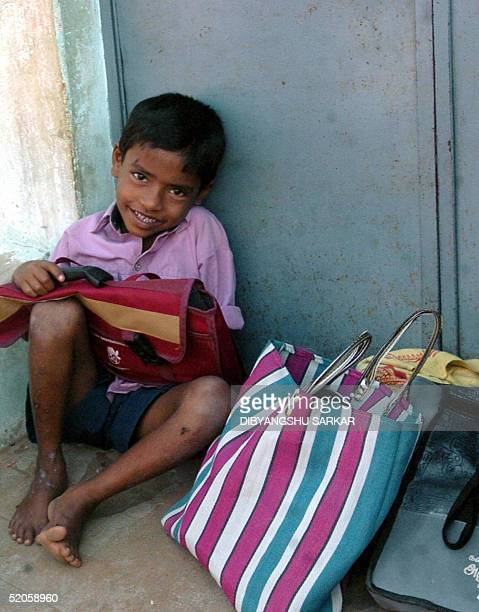 An Indian child tsunami survivor waits for teachers as she sit in front ofa school building in the fisherman village of Kuttiammankoil some 300 Kms...
