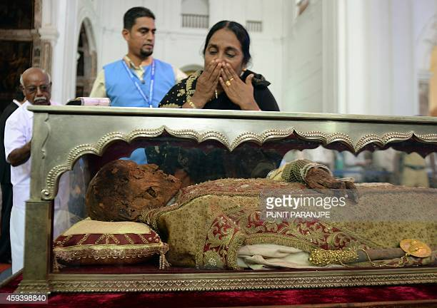 An Indian Christian pays her respect to the remains St Francis Xavier at the Se Cathedral in Goa on November 22 2014 The 17th exposition of the body...
