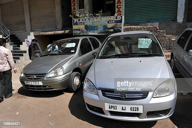 An Indian client inspects a second hand car on display during an automobile sale at an outlet in Hyderabad on February 5 2011 Used cars and...