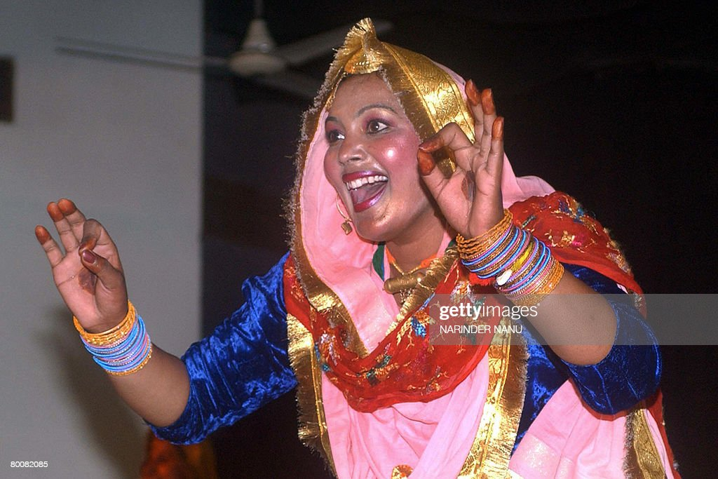 An Indian college girl performs the traditional Punjabi dance `Giddha` during celebrations of the `Jashan` Inter Departmental Cultural competition at.