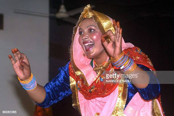 An Indian college girl performs the traditional Punjabi dance 'Giddha' during celebrations of the 'Jashan' Inter Departmental Cultural competition at...