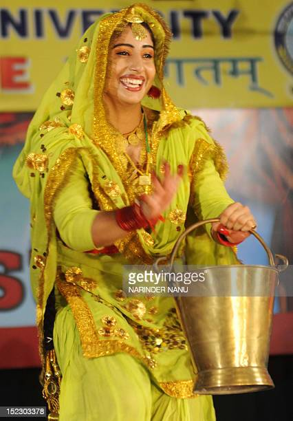 An Indian college student performs a traditional Punjabi dance during a Youth Festival competition at Guru Nanak Dev University in Amritsar on...