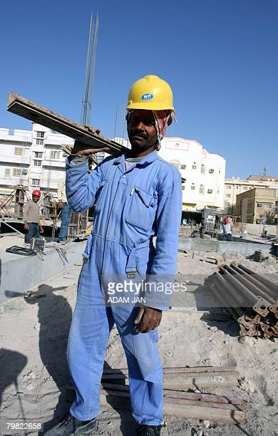 An Indian construction worker labours at a site in Manama on February 18, 2008. Over the past three weeks, hundreds of workers in the kingdom, almost...
