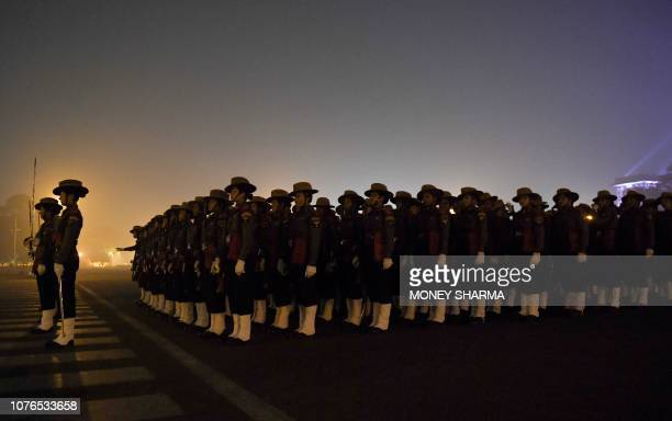 An Indian contingent of Assam Rifles stands in a predawn rehearsal for the forthcoming Republic Day parade in New Delhi on January 2 2019 India will...