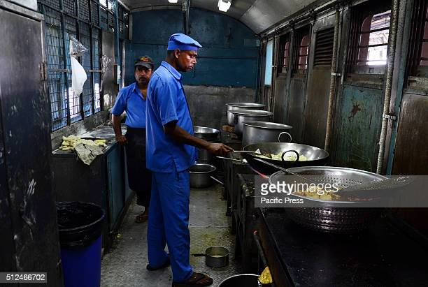 An Indian cook preparing food for Commuters in a pantry car at Allahabad railway junction On the day Railways Minister Suresh Prabhu unveiled the...