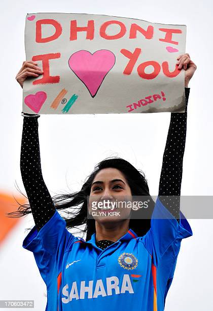 An Indian cricket fan holds a banner reading Dhoni I [love] you referring to Indian captain Mahendra Dhoni during the 2013 ICC Champions Trophy...