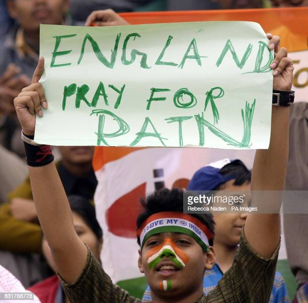 An Indian cricket fan hols a banner at the Nehru Stadium Guwahati India Sunday 9th April 2006 The 5th ODI between India and England has been delayed...