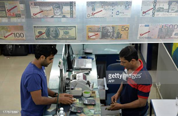 An Indian customer at a foreign exchange outlet changes Indian rupees in Bangalore on August 24 2013 The rupee staged a sharp recovery against the...