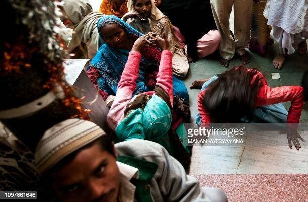 An Indian devotee believed to be possessed by evil spirits goes into a state of trance at the Hazrat Shahdana Wali Dargah in Bareilly around 300kms...