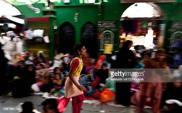 An Indian devotee believed to be possessed by evil spirits runs in a state of trance at the Hazrat Shahdana Wali Dargah in Bareilly around 300kms...