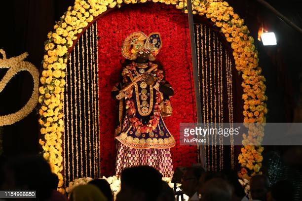 An Indian devotee dressed as the Hindu deity Lord Krishna during a religious event ahead of the Jagannath Rath Yatra in Ajmer India on 10 July 2019