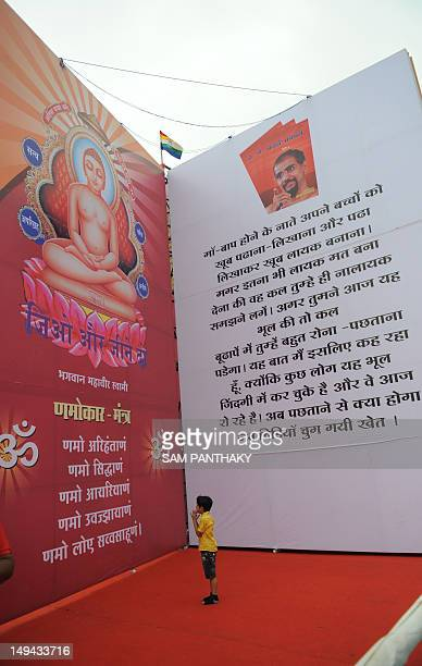 An Indian devotee from the Jain community looks at a huge replica of the 'Kadve Pravachan' religious book during its launch in Ahmedabad on July 28...