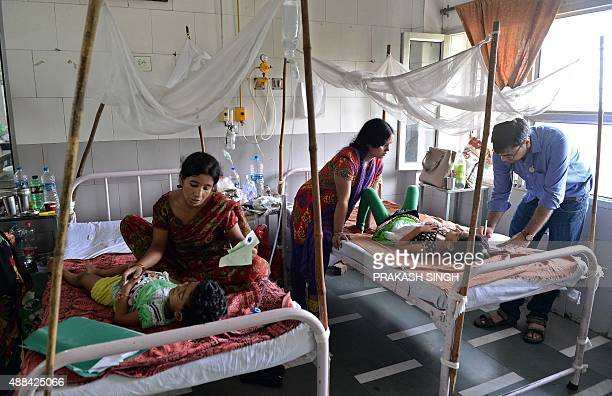 An Indian doctor attends to dengue patients in a dengue pediatric ward of The Hindu Rao hospital in New Delhi on September 16 2015 The Indian capital...