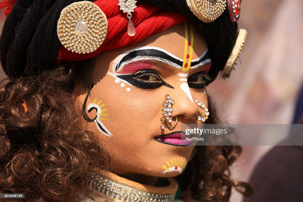 An Indian dressup artist of ' Lord Krishna' during the Kite Festival