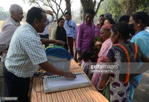 An Indian election official explains the procedure to cast a vote on Electronic Voter Verifiable Paper Audit Trail machines and Electronic Voting...