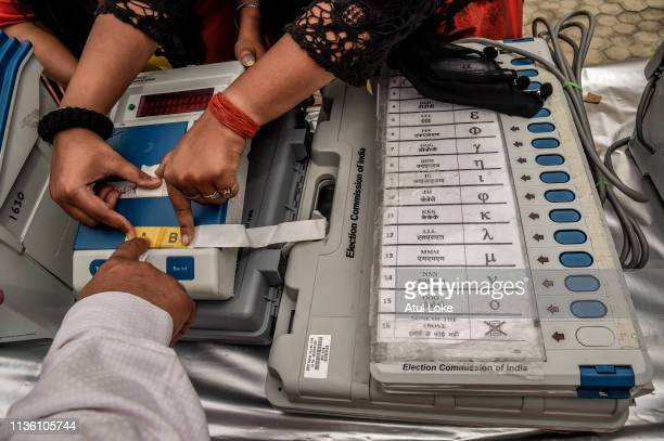An Indian election worker learns how to operate voting machines at an Elections Commission facility before moving to a polling station on April 10,...