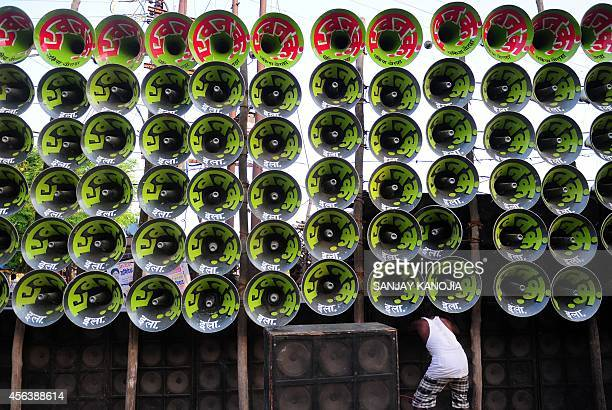 An Indian electrician arranges loudspeakers during a Dusshera festival loudspeaker competition ahead of the forthcoming Dusshera festival in...