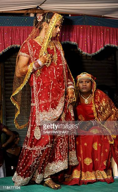 An Indian eunuch dressed in wedding attire arrives on stage in Ahmedabad on July 12 2009 In the presence of some one hundred eunuchs of the...
