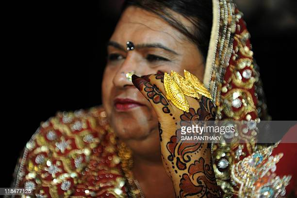An Indian eunuch gestures during a eunuch wedding reception in Ahmedabad on July 12 2009 In the presence of some one hundred eunuchs of the...