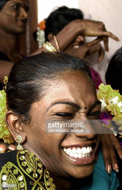 An Indian eunuch laughs during a meeting to discuss a High Court Judgement in Madras 25 March 2004 Madras High Court issued a judgement 23 March in...
