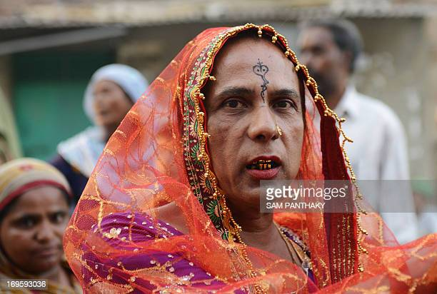 An Indian Eunuch looks on during a Rafai Silsila a religious procession to offer a ceremonial Chaddar at the ShahEAlam Roza in Ahmedabad on May 28...
