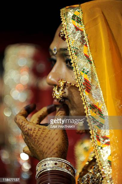 An Indian eunuchs gestures during a eunuch wedding reception in Ahmedabad on July 12 2009 In the presence of some one hundred eunuchs of the...