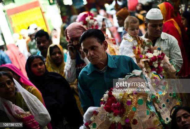 An Indian family brings their newly born children to seek blessings at the Hazrat Shahdana Wali Dargah in Bareilly around 300kms from New Delhi on...