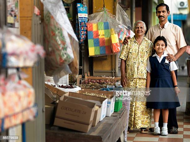 An Indian family outside their dry goods shop