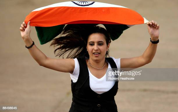 An Indian fan celebrates as they secure victory during the ICC Women's Twenty20 World Cup match between India and Sri Lanka at The County Ground on...