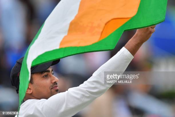 An Indian fan celebrates Australia's Nathan McSweeney being caught during the U19 World Cup cricket final match between India and Australia at Bay...
