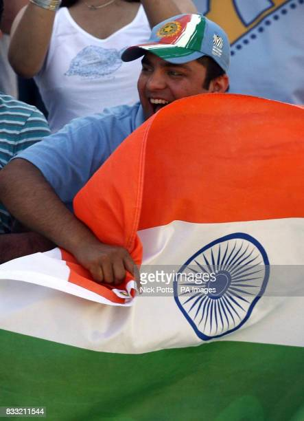 An Indian fan celebrates the win over England during the fifth day of the Second npower Test match at Trent Bridge Nottingham
