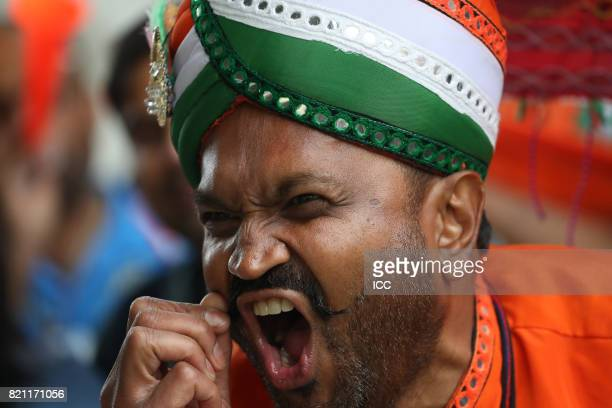 An Indian fan enjoys the action during The ICC Women's World Cup 2017 Final between England and India at Lord's Cricket Ground on July 23 2017 in...