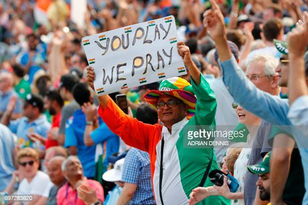 An Indian fan holds up a placard during the ICC Champions Trophy final cricket match between India and Pakistan at The Oval in London on June 18 2017...