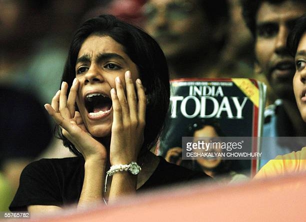 An Indian fan shouts to support Indian tennis star Sania Mirza during her doubles semi final match at the Sunfeast Open 2005 in Kolkata, late 24...