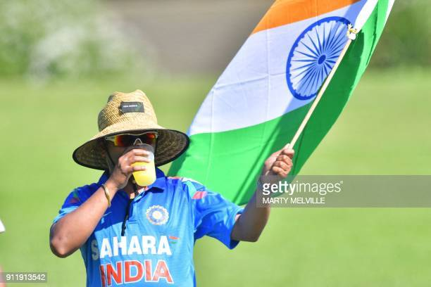 An Indian fan walks with a flag during the U19 semifinal cricket World Cup match between India and Pakistan at Hagley Oval in Christchurch on January...