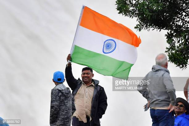 An Indian fan waves an Indian flag during the U19 World Cup cricket final match between India and Australia at Bay Oval in Mount Maunganui on...