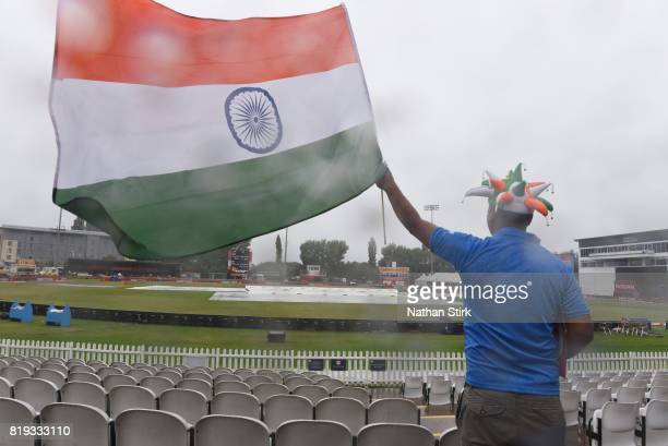 An Indian fan waves his flag as he awaits for the rain to stop during the SemiFinal ICC Women's World Cup 2017 match between Australia and India at...