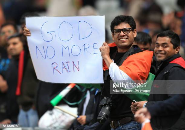 An Indian fans holds a sign asking for no more rain during the ICC Champions Trophy Final at Edgbaston Birmingham