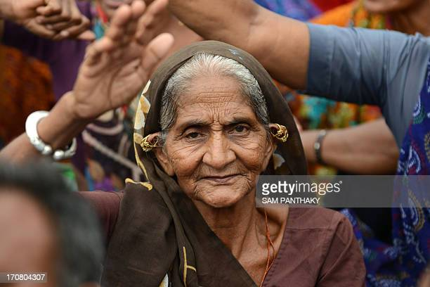 An Indian farmer demonstrates during a rally in Gandhinagar capital of India's Gujarat state some 30 kms from Ahmedabad on June 18 2013 Nearly 5000...