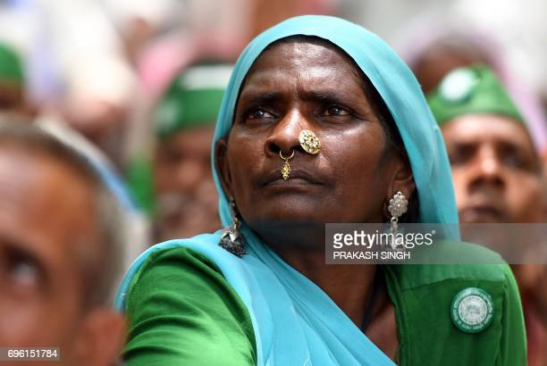 An Indian farmer of the Bhartiya Kisan Union listens a speech during a protest against Prime Minister Narendra Modi and the Madhaya Pradesh state...