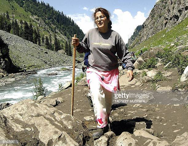 An Indian female Hindu pilgrim walks close to the village of Chandanwari some 114kms south of Srinagar.15 July 2004. Some 1,000 Hindu pilgrims set...