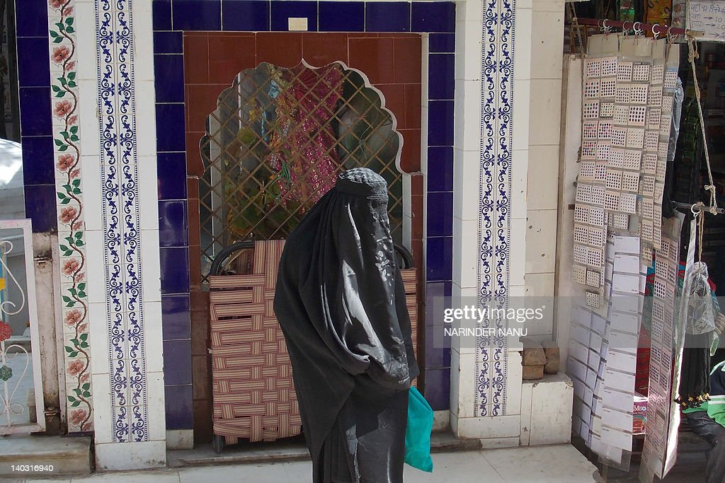 An Indian film extra is seen wearing a burqa for a scene depicting Pakistan's Abbottabad town in Kathryn Bigelow's forthcoming film on Osama bin..
