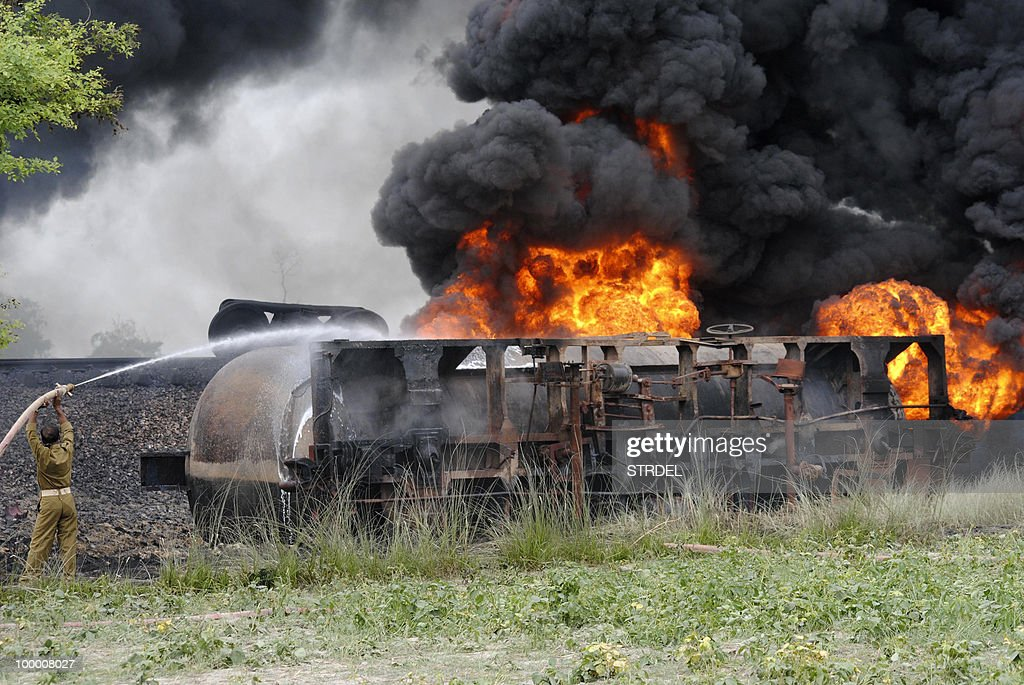 An Indian firefighter attempts to extingush a fire in an oil tanker part of a goods train at Chintawanpur some 200kms north of Patna on May 20, 2010, after it was derailed and set alight by suspected Maoist insurgents. The left-wing guerrillas have stepped up attacks in response to a government offensive that began late last year in the forests of a so-called 'Red Corridor' stretching across northern and eastern India. The insurgency began in the state of West Bengal in 1967 in the name of defending the rights of tribal groups, and has since spread to 20 of India's 28 states.