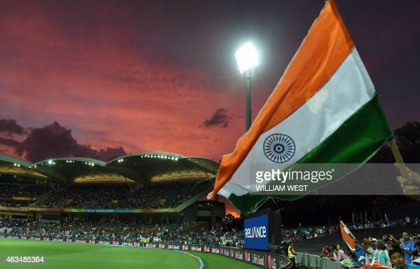 An Indian flag is waved during their 2015 Cricket World Cup match between India and Pakistan in Adelaide on February 15 2015 AFP PHOTO / William WEST...