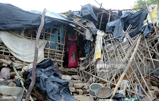 An indian flood victim woman stand in her house which was totally vanished and destroyed in floods in nearby areas of Ganges River in Allahabad on...