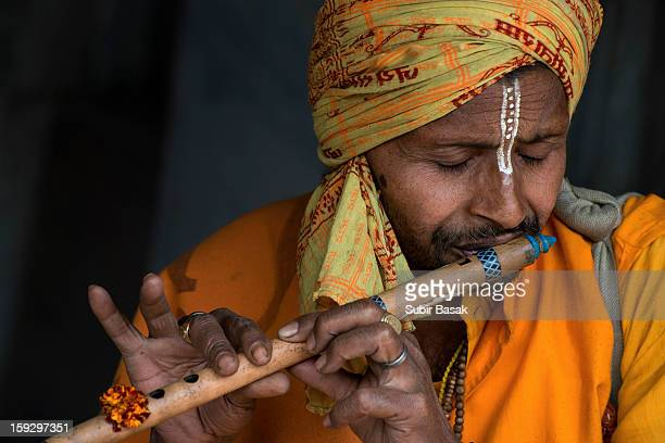 An Indian Flutist perform with handmade flute