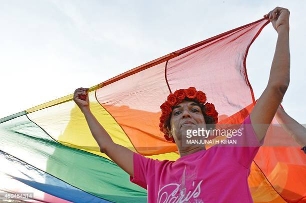 An Indian gayrights activist poses for a photograph as he carries a flag during the annual Bengaluru Pride March in Bangalore on November 23 2014 The...