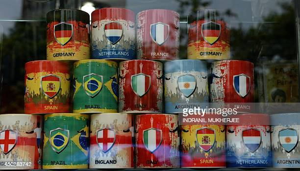 An Indian gift shop window is decorated with mugs in colours of various football playing countries ahead of the forthcoming FIFA World CUP 2014 in...