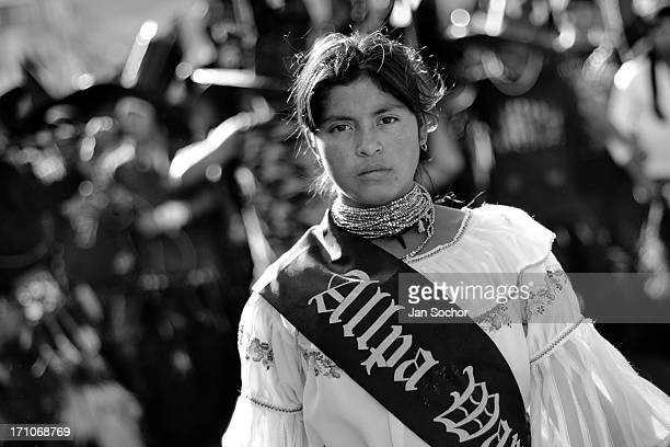An Indian girl, a beauty contest winner, walks in the procession during the Inti Raymi festivities on 24 June 2010 in Cotacachi, Ecuador. La toma de...